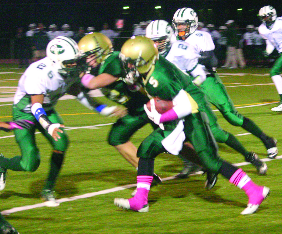 PLAYOFF TIME: Mitch Lucci runs for Hendricken in its regular season meeting against Cranston East. The Hawks and Bolts meet ahain tonight.