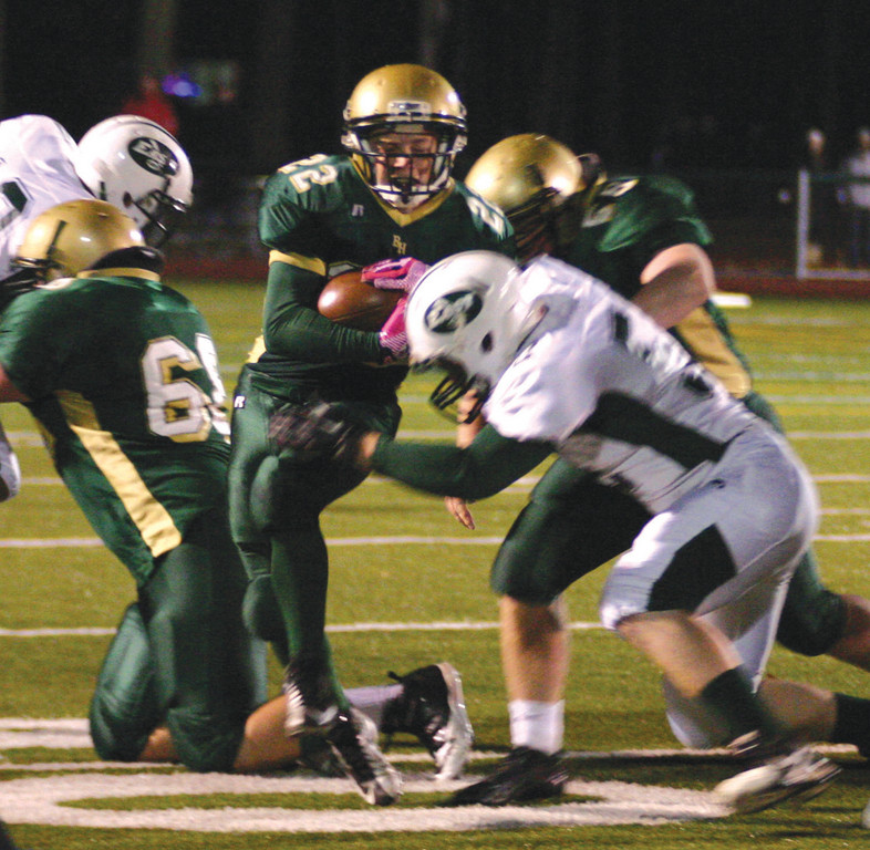 STAYING UP: Remmington Blue tries to break a tackle near the line of scrimmage in Wednesday's game. Blue rushed for 189 yards, 180 of which came in the second half.