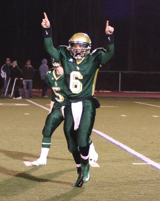HANDS UP: Hendricken's Patrick Gill celebrates his team's final touchdown in a 35-21 victory over Cranston East in the Division I semifinals on Wednesday. The Hawks will make their third straight Super Bowl appearance when they face No. 1 La Salle on Sunday.