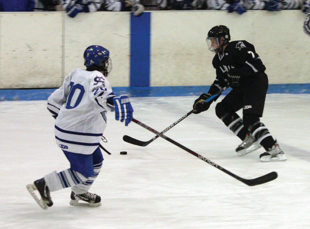 UP THE ICE: Ryan Oatley dribbles the puck past a defender during a game last season. Oatley is back in the fold for Pilgrim and is expected to be one of its top offensive options.