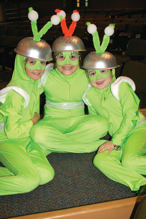 AN EXTRA MERRY CHRISTMAS: The Johnston Dance and Performing Arts troupe (J-DAPA) will perform their holiday show, �An Extraterrestrial Christmas� this Friday and Saturday, Nov. 30 and Dec. 1, at 6:30 p.m., with an additional matinee performance at 1:30 p.m. Saturday. The show will take place in the Johnston High School auditorium, and tickets are $7, or $5 for seniors, students and children. Pictured here, Isabella Waldron, Danielle Warren and Jacqueline Lebeuf wait for their turn onstage at rehearsals for �An Extraterrestrial Christmas.�