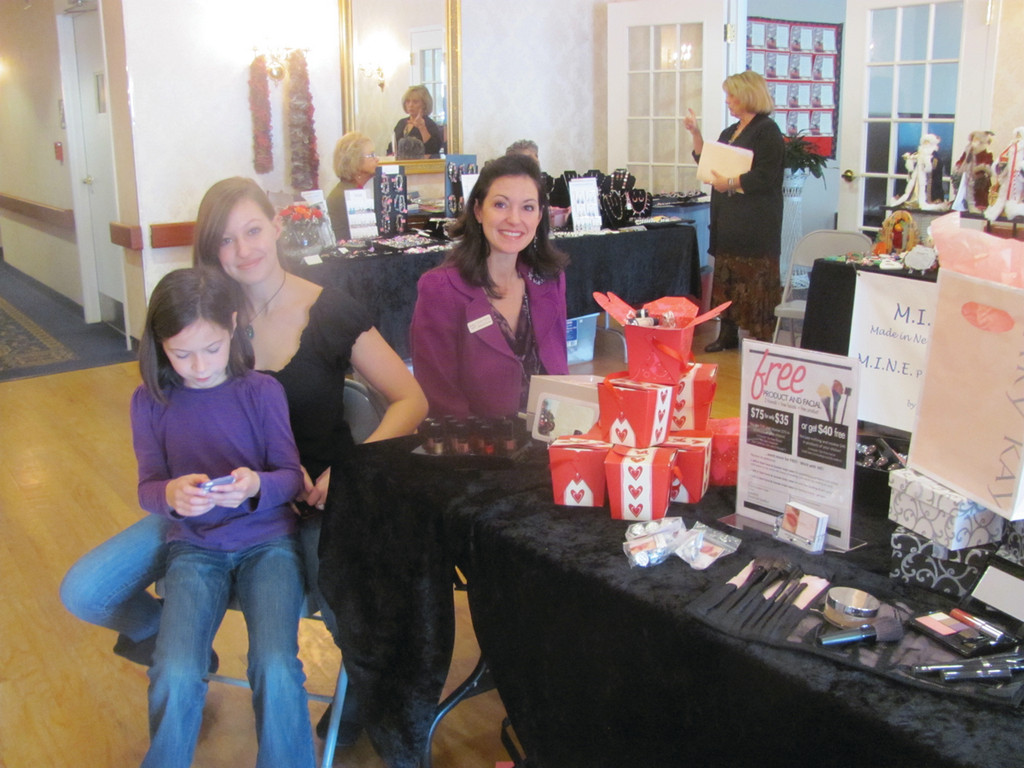 Christan Morales, an independent consultant with Mary Kay, set up shop at The Bridge at Cherry Hill�s Fall Festival Saturday along with her daughters Karin and Abigail.