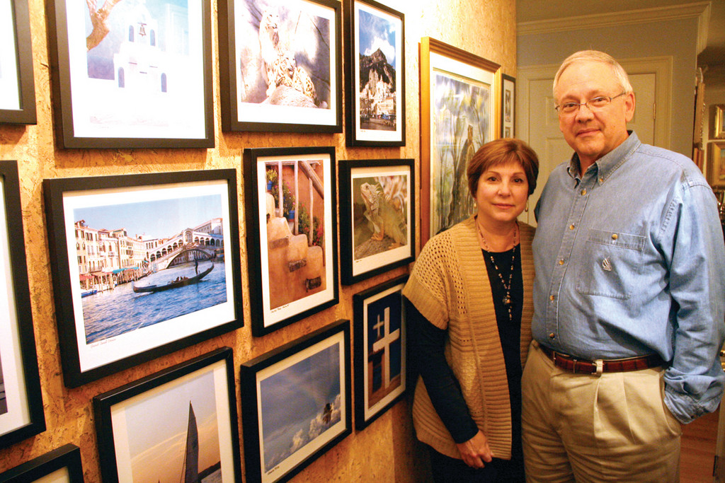"THEIR HOME IS A GALLERY: John and Teresa Bert in the hallway of their Warwick Neck home. The photographs are John's. Terri's displays the artistic talents in their kitchen. The couple has published ""The Italian Way,"" a collection of Terri's recipes with photographs taken by John."