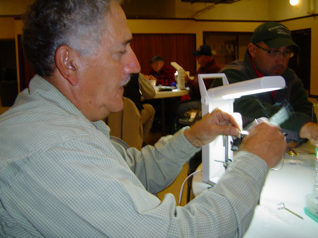 Fresh or saltwater fly tying is great fun:  Jim Mancini of East Greenwich, RI works on his peanut bunker fly at a United Fly Tyers of RI meeting.  Membership for a year is $30 which includes all supplies for ten fly tying meetings. This is a great holiday gift.