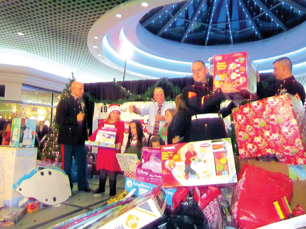 BIG BOB: Rhode Island residents, including Bob Venturini, (center) and Edward Brady, are rallying people to donate new and unwrapped gifts to benefit Toys for Tots and Toy for Teens. Along with the United States Marine Corps, Venturini annually hosts a telethon at Warwick Mall.