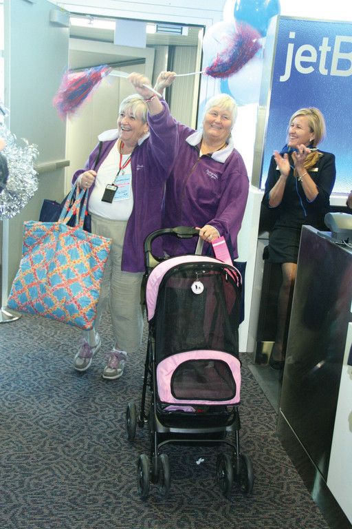HAPPY TO BE BACK IN RI: Brandishing pompoms, Sisters Bonnie Craven and Gail Yount were on jetBlue's inaugural flight into Green. They have Rhode Island roots and bragged about them.