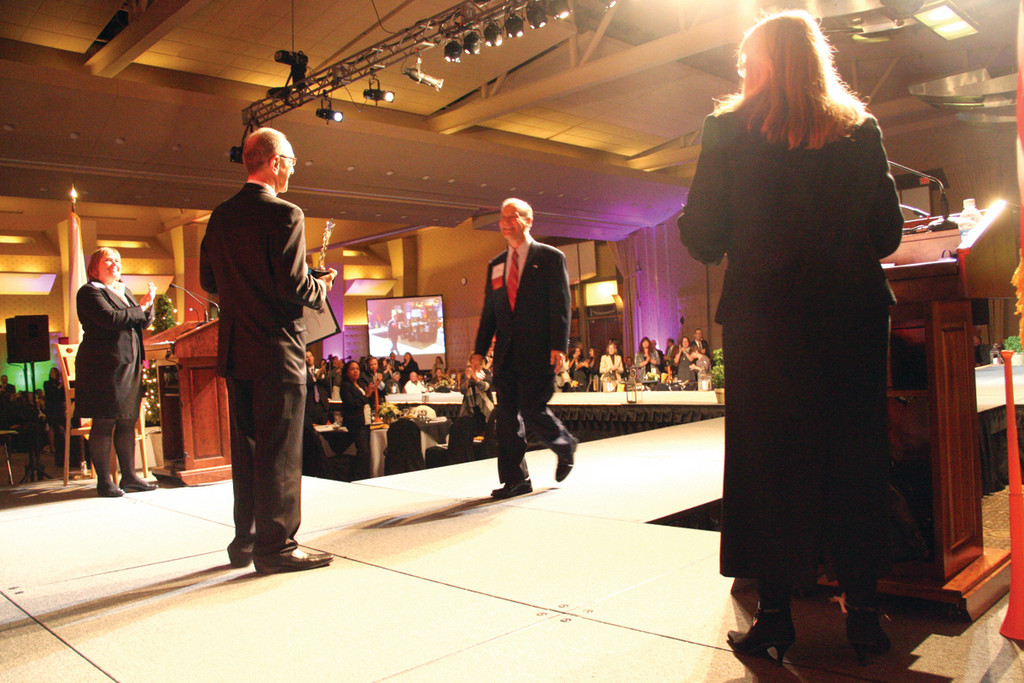 WALKING THE RUNWAY: David DePetrillo approaches the stage to receive the lifetime achievement award during the Stars of the Industry celebration held Wednesday at the RI Convention Center.