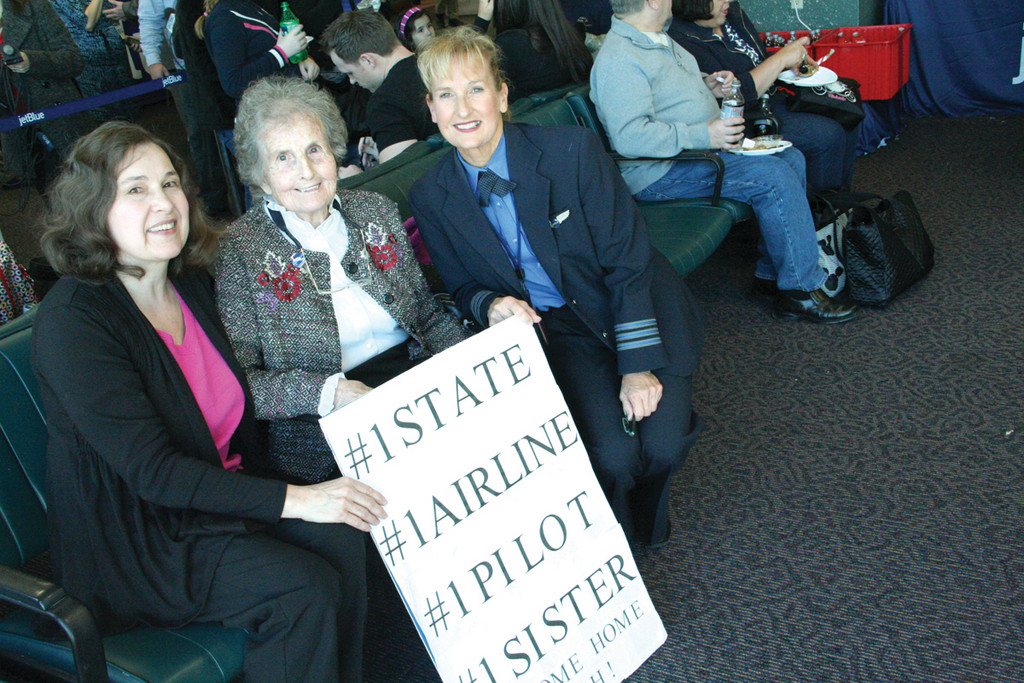 A FAMILY AFFAIR: First officer and pilot Patricia Socha, who grew up in Rhode Island, requested to fly the first flight into Green. There to meet her was her sister Cathy Michael and mother Elizabeth Socha.