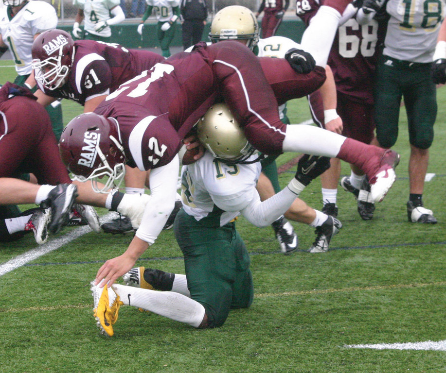 TUMBLING: Hendricken's Power Kanga upends La Salle quarterback Anthony Francis during Sunday's game.