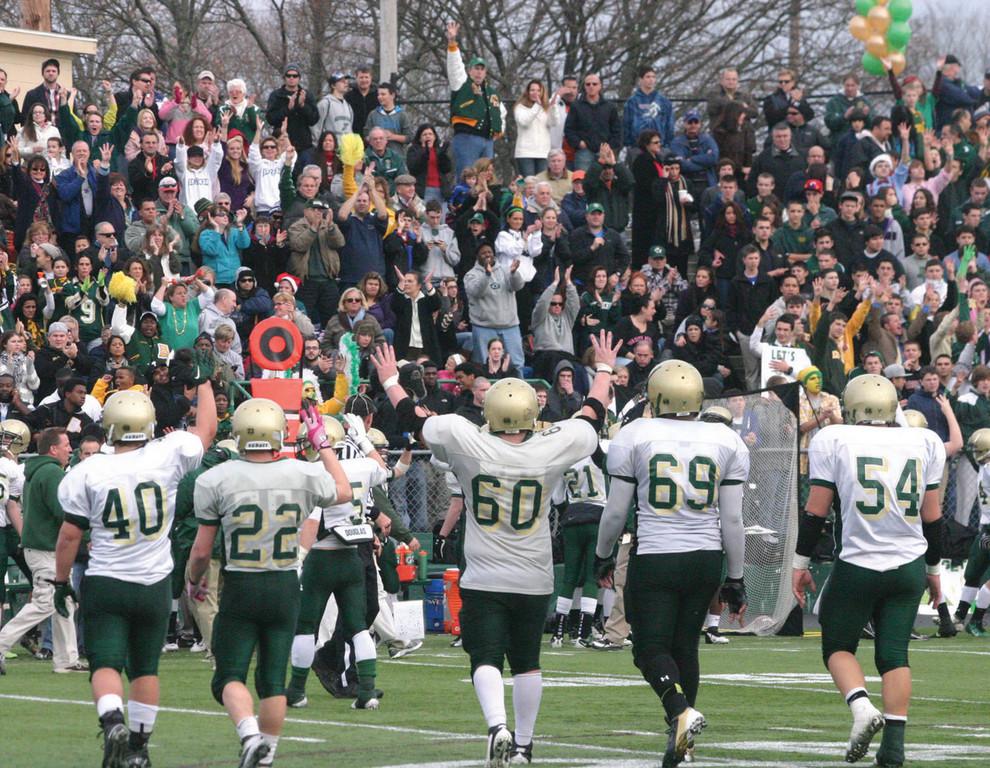 LAST STAND: Hendricken players hold four fingers in the air as they head to the sideline before the beginning of the fourth quarter.
