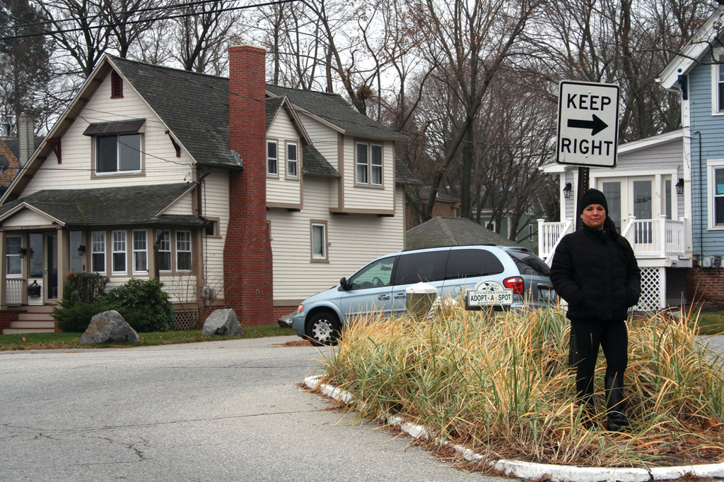 DANGER ZONE: Juana Horton of Ocean Avenue stands on the island at the intersection of Ocean and Narragansett Boulevard. The area has been the site for many accidents, including one in which a vehicle plowed into Horton's home. She hopes a public meeting next Monday will help alleviate problems in the area.