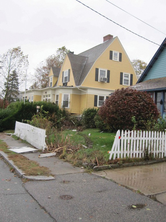 BROKEN DOWN: This picket fence was destroyed by a speeding vehicle on Ocean Avenue.