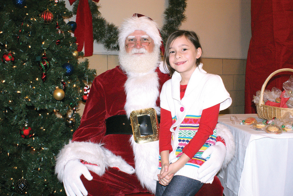 SWEET EMILY: Sitting upon Santa Claus�s lap is 8-year-old Emily Lopez. She is the daughter of Carlos Lopez Estrada, chief of staff for Mayor Allan Fung.