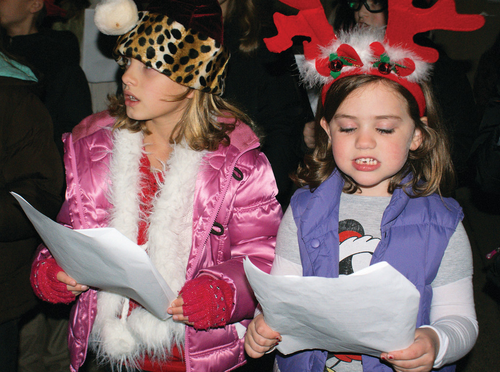 KEEPING IT BASIC: Pictured are 8-year-old Madison Mallett and 5-year-old Kaileigh Kelleher, singing Christmas carols in the BASICS chorus.
