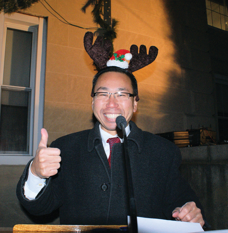 LIGHTING THE TREE: Mayor Allan Fung dons antlers as he welcomes the crowd to the city�s annual tree lighting.