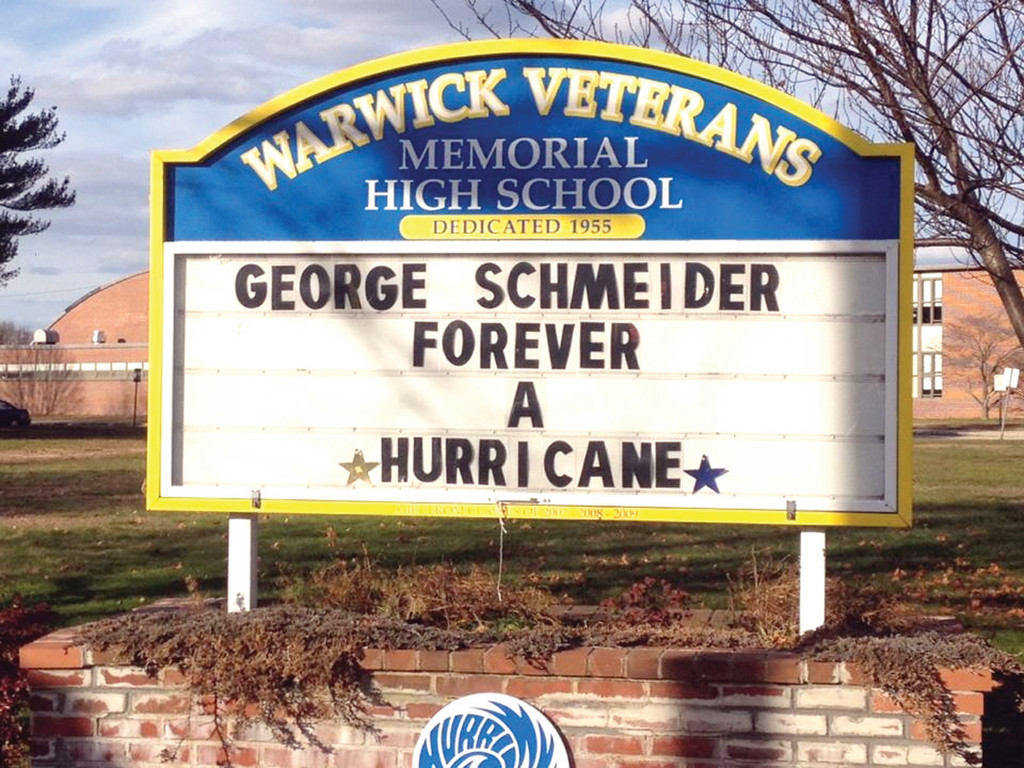 "After battling an illness since August, George Schmeider, a teacher at Gorton Junior High and longtime coach at Warwick Vets, passed away on Monday. To honor him, the sign at the entrance to Vets is adorned with the words, ""George Schmeider: Forever a Hurricane."""