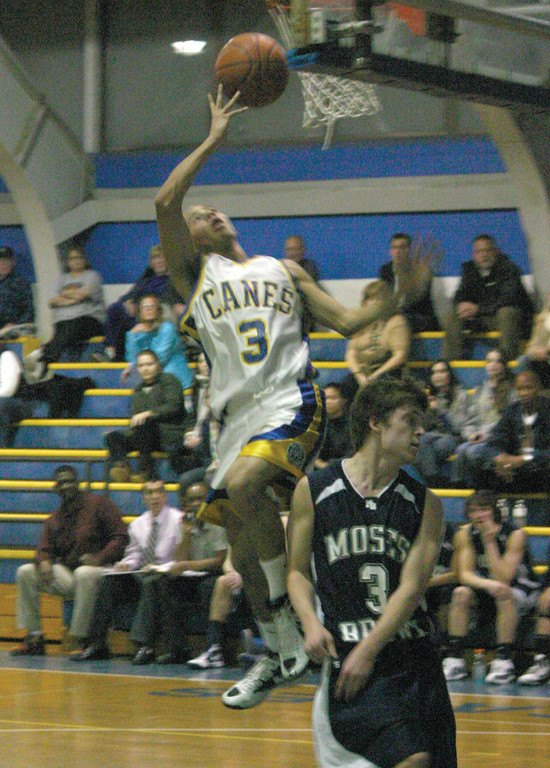 Carter Thomas tries to finish at the hoop during a game last season.