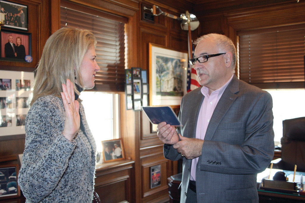 Lori Pezzullo is sworn in as a member of the Planning Board by Mayor Joseph Polisena in his Town Hall office on Monday.