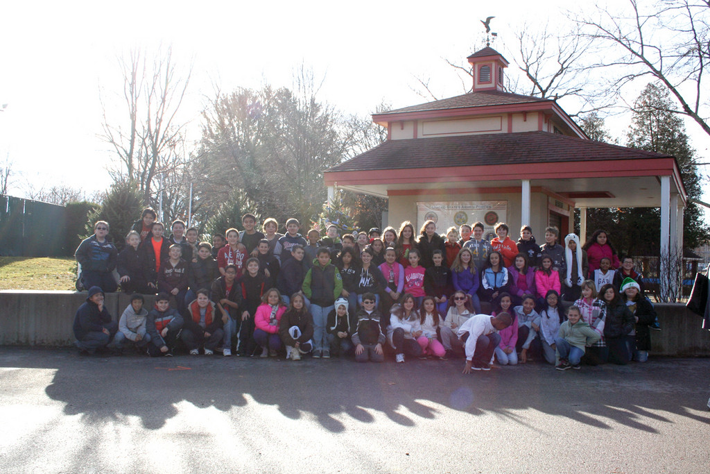 The three fifth grade classes from Winsor Hill had their Christmas tree decorated within 10 minutes yesterday before piling back onto the bus carrying the next school. The trees were donated to the Parks and Recreation Department from Jacavone Garden Center on Atwood Avenue.