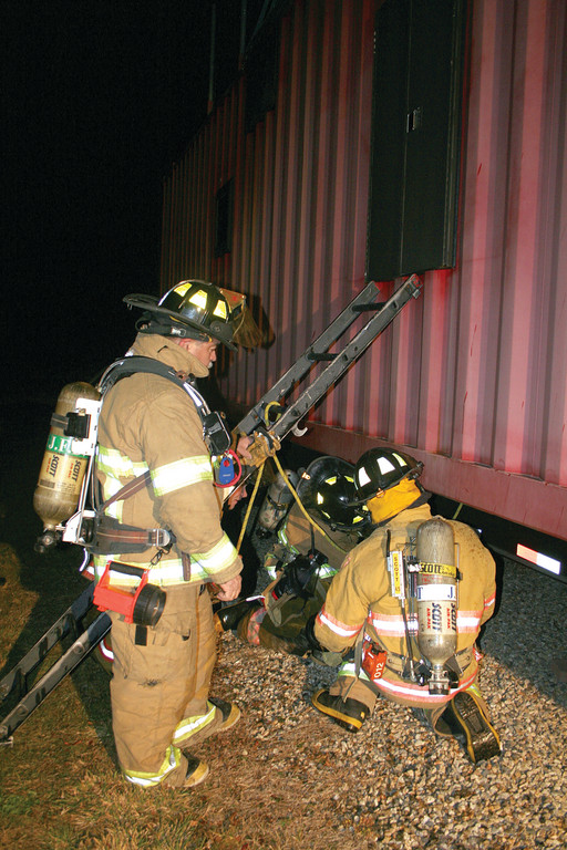 Recruits prepare to enter the burn trailer from a different vantage point.