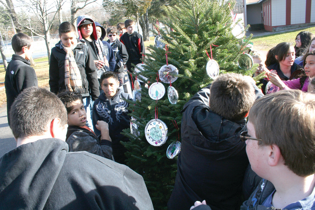 Winsor Hill students gather around their tree, rushing to get a good spot for their ornament.
