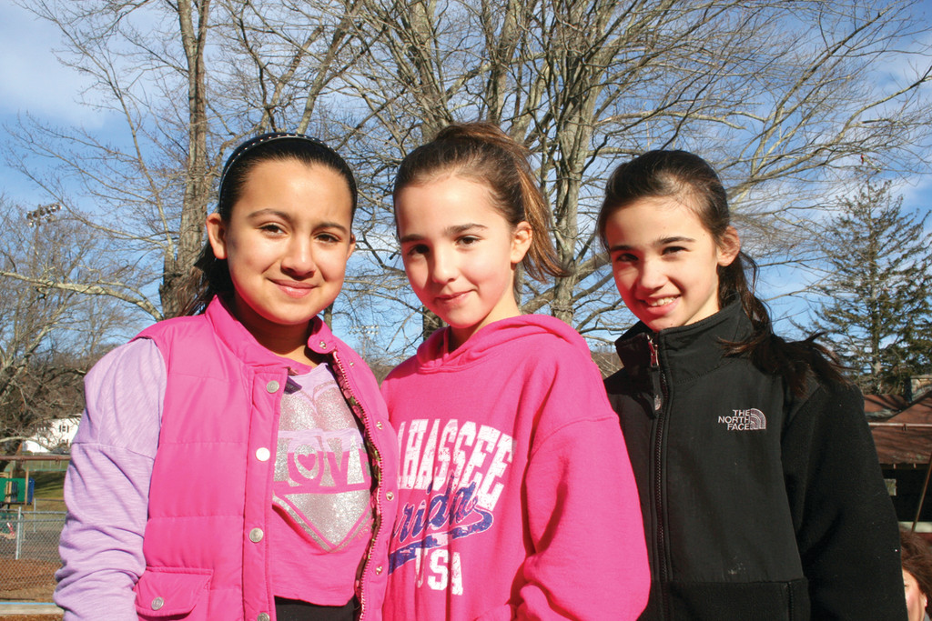 Natalie Saleh, Morgan Plouffe and Juliana Manchester pose for a photo after hanging up their ornaments.