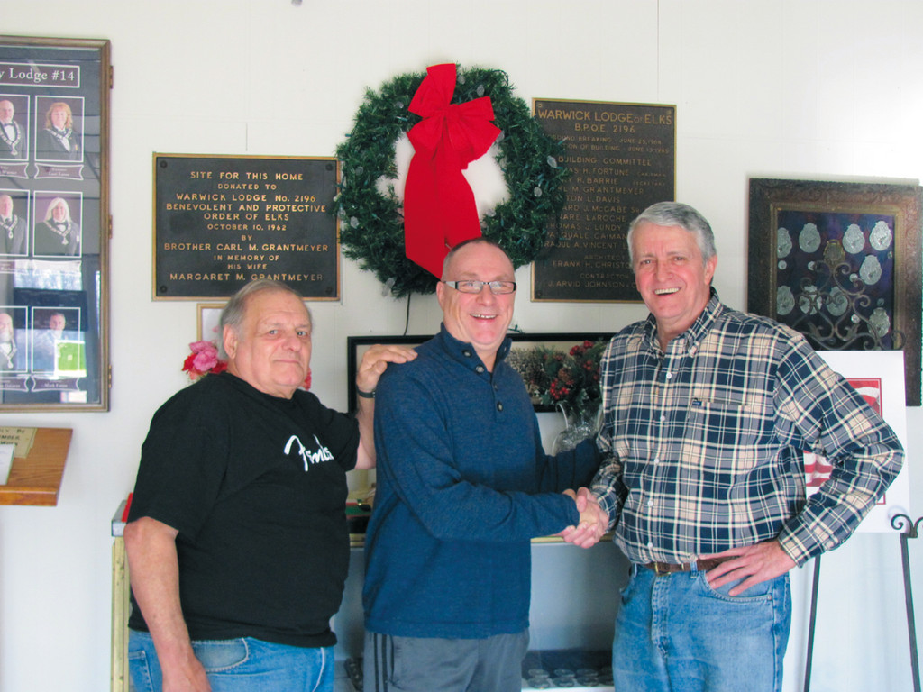 MUSIC MAN: Roger Ceresi (center) gets a �welcome home� handshake from Peter G. Dodge, House Committee Chairman at the Tri-City Elks Lodge 14 on West Shore Road where the noted singer-band leader will bring his All-Starz Saturday evening for a Pre-Christmas Dance Party. Looking on is Joe Martini, the group�s co-manager and booking agent.