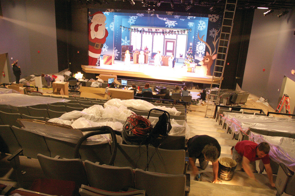 DRESS REHEARSHAL: As crews install carpeting on cement riser aisles, the cast of the Wonderettes prepares for last night's opening