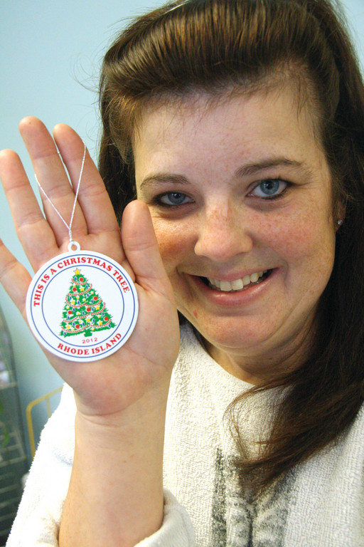ORNAMENT LADY: Ronda LaChapelle created an ornament bearing the phrase �This is a Christmas Tree,� a jab at Governor Chafee�s decision to call the State House tree a �Holiday Tree� yet again. She�ll sell the ornaments for $10, and donate $2 from each sale to Toys for Tots.