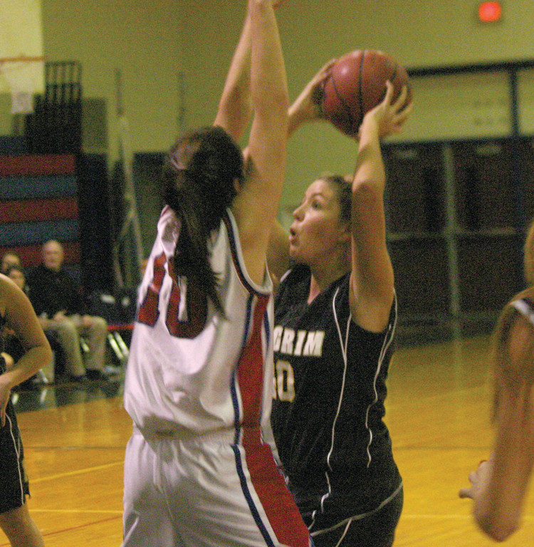 ALL OUT: Toll Gate's Courtney Sheridan plays defense on Pilgrim's Janelle Paliotte during Thursday's game.