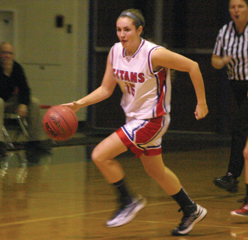 BRINGING IT UP: Toll Gate's Laura McGuire heads into the front-court during Thursday's non-league season opener against Pilgrim. The Titans, who went winless last season, started strong and held off a late charge from Pilgrim to win 48-41.