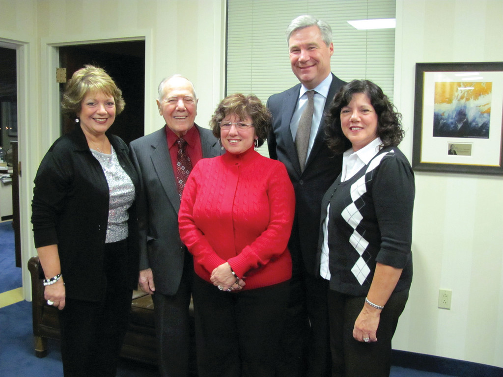 HONORING DAD'S SERVICE: Mario Perri's three daughters – Diane Pagliarini, Patricia Robida and Sandra Torti – and Sen. Whitehouse are all smiles as they honor Perri for his service to the country.