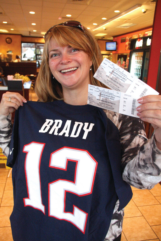 SHE'S GOT A DATE SUNDAY: Jennifer Silvio was one of a dozen lucky Dunkin' Donuts customers to win a pair of tickets to Sunday's Patriots game after buying a dozen donuts.