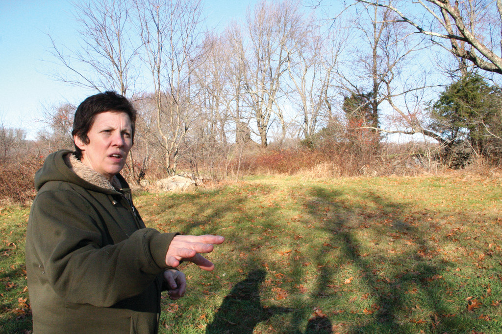 VISION FOR A FARM: Kathleen Schofill, the head of the reconstituted Barton Farm Conservancy, shows where a handicapped accessible trail might begin at the former dairy farm.