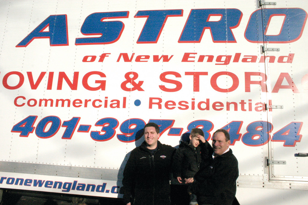 MOVING GESTURE: After finding out that Neighbors Helping Neighbors is in need of donations, Chuck Lamendola (right), owner and operator of moving and storage company Astro of New England, donated $1,000 to the cause. He holds his grandson, Julian Johnson, 3, and smiles with his son, Justin.