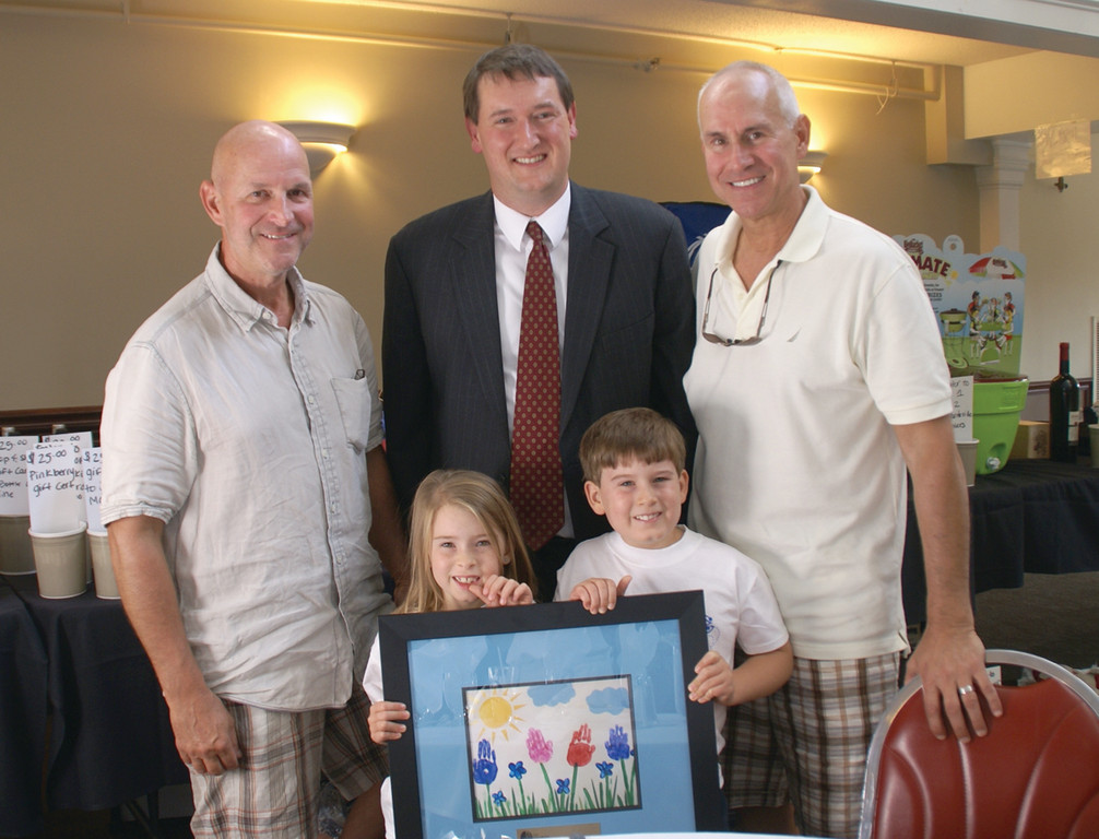HELPING THE PROVIDENCE CENTER: Craig Chelo, Ian Lang of the Providence Center and Glenn Chelo are joined by children Olivia and Joseph Weidele to recognize the $12,080 raised for the benefit of the center at the recent Chelo's 25th Annual Golf Classic.