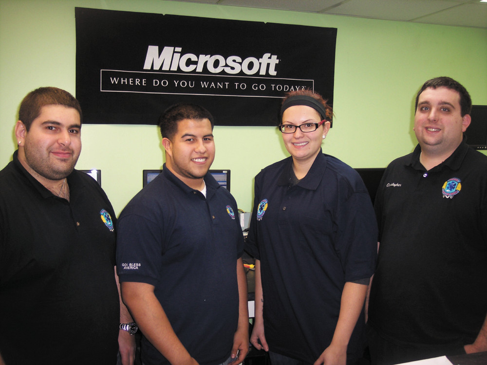 Meet the team of experts at Tech 911 - Ron Stabile, manager Ron Vallee, April Cox and owner Chris Dias.