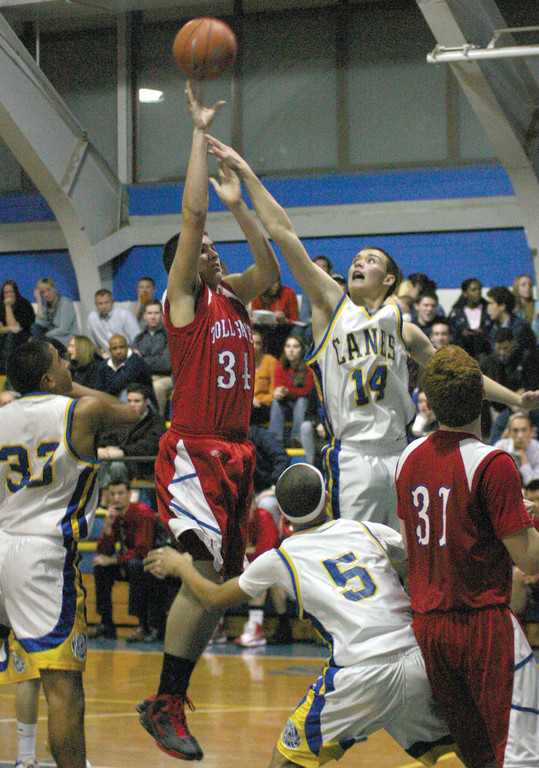 ABOVE THE FRAY: Toll Gate's John Coleman takes a jump shot as Vets' Will Remak tries to defend him in Tuesday's league opener. Coleman had 21 points in Toll Gate's 68-42 win.