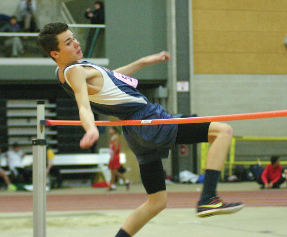 UP AND OVER: Toll Gate's Pat Rocchio clears the bar in the high jump during Monday's meet.