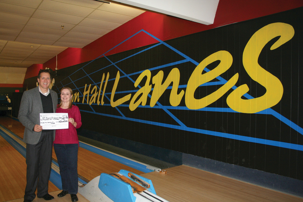Town Hall Lanes owner Frank Ferri and longtime employee Cheryl Bartolini show off the grand total figure � $2,750 � they raised this year for St. Jude Children�s Research Hospital.