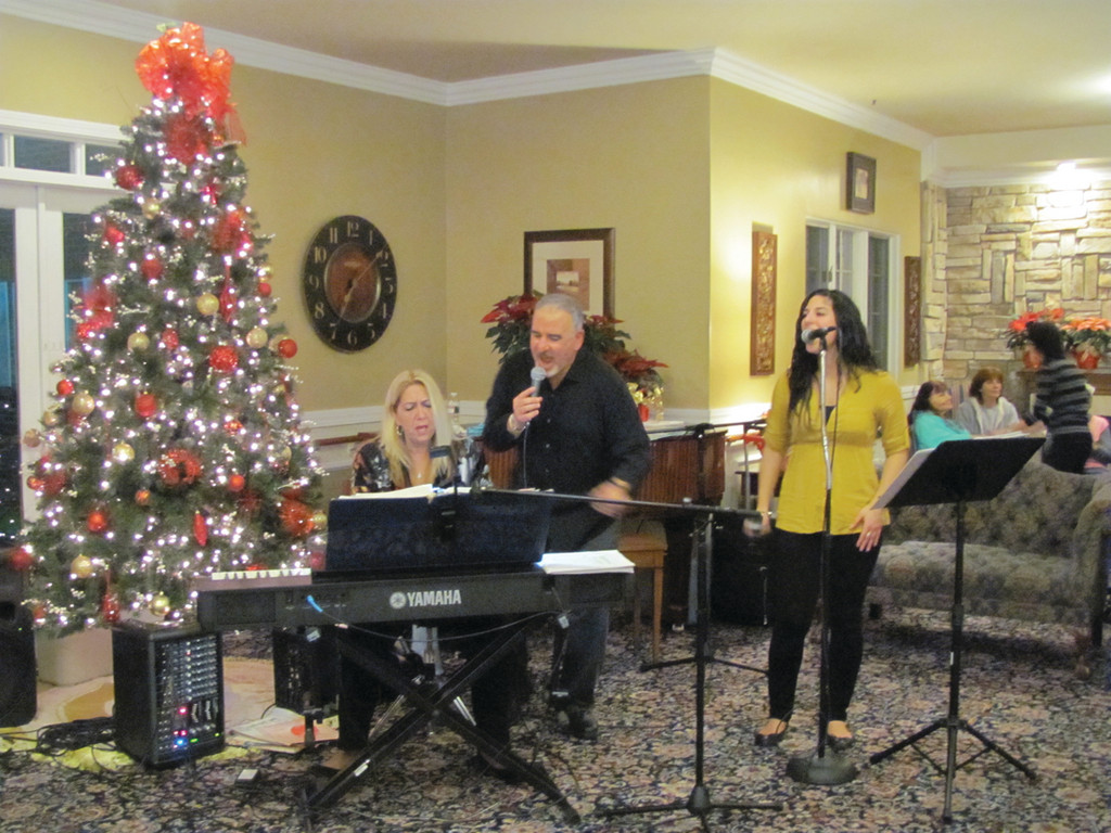 Thomas, Charlene and Giulia Khoury treat residents and staff at Cherry Hill Manor to a Christmas Concert last Thursday evening.