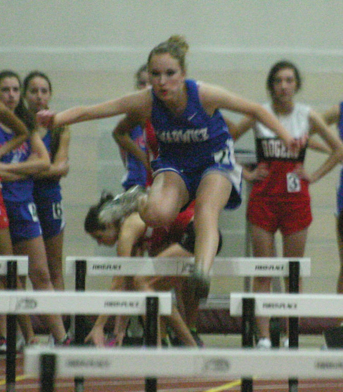 UP AND OVER: Vets' Katelyn Ravenell competes in the hurdles during Thursday's season opener.