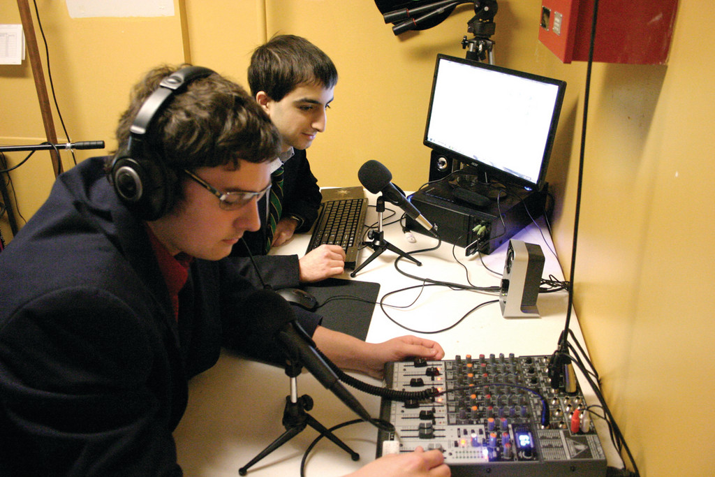TUNE IN: A recent $4,000 donation allowed Bishop Hendricken High School to enhance its Internet radio station, which was created by a former student four years ago. Seniors Mason Szeligia, 17, (left) and Station Manager Jim Kent, 18, co-host shows such as Loaded Music and Sports City.