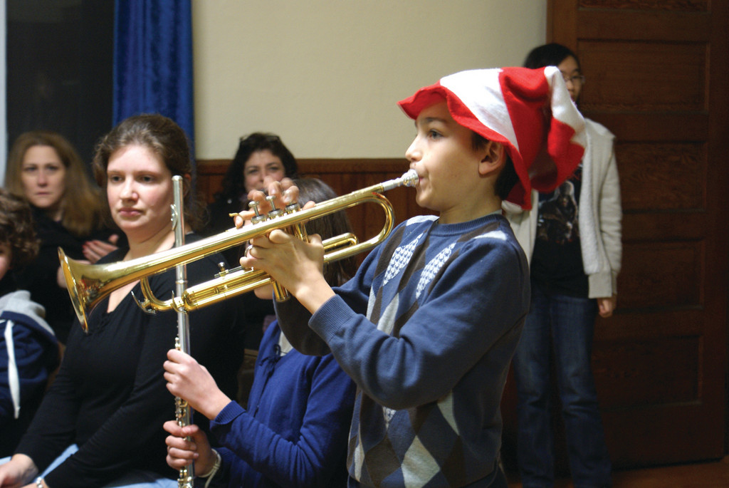 SOLO ACT: Troy Cedarfield, age 11 and a fifth grade student at Eden Park Elementary School, and member of BASICS, plays a trumpet solo during the musical program.
