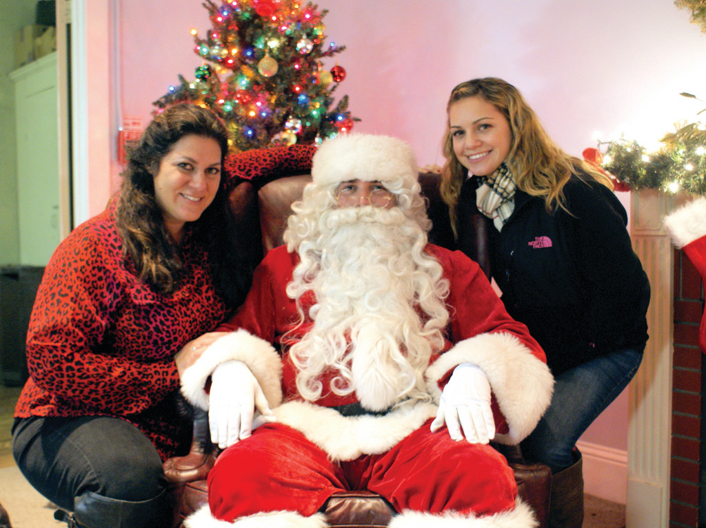 FAMILY TIME: The Oaklawn Grange, established in 1914, held their fourth annual Christmas Tree Lighting last week featuring both outdoor and indoor festivities, including the lighting of the Christmas Tree and the Gazebo, a visit from Santa Claus, music and refreshments. Pictured are Maria Manzi, Santa Claus and Manzi's daughter, Brittney Huddleston.