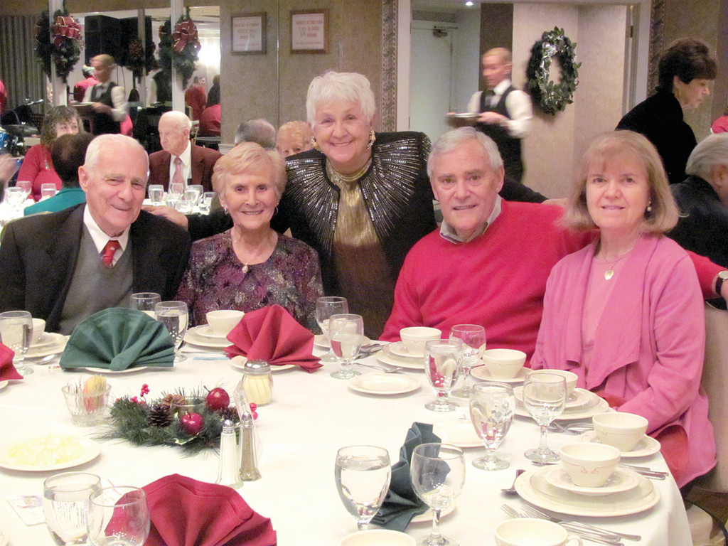 Lori DeVito (center), who is president of the Manton Seniors, joins new members George and Irene Boisse and Maureen and Pat Nassaney at Sunday's Christmas Party that was held at Twelve Acres in Smithfield.