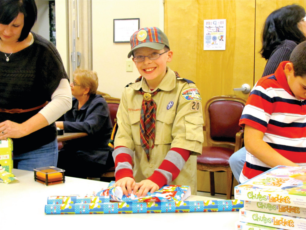 Anthony Andriole, 11, and David DiIorio, 10, who are fifth graders at Barnes Elementary School, tuned out last Thursday night to help the Explorers Post 405 wrap Christmas presents for needy children.