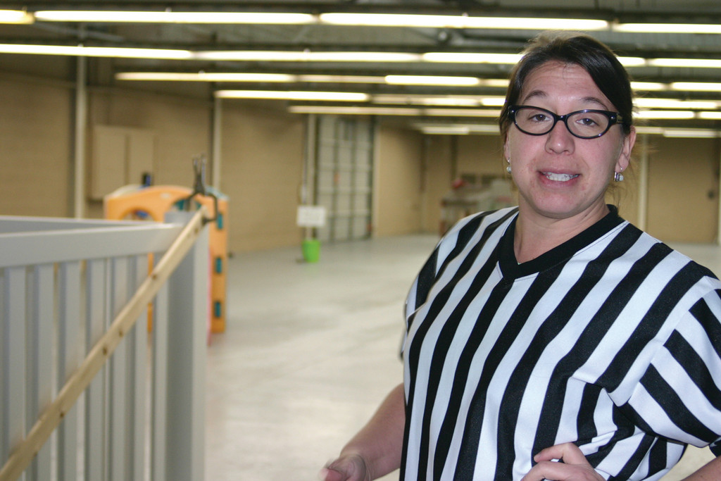 DOG REF: Alisa Paykos-Theurer is the woman behind Bow Chika Wow Town, Warwick's first indoor dog park, located just off Post Road. The indoor park located off Airport Road includes 8,700 square feet of playing space, doggie day care and boarding facilities.