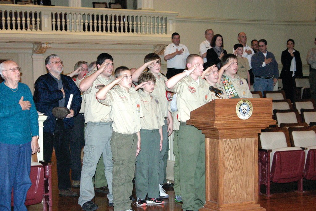 SCOUTS HONOR: Boy Scout Troop 49 Lakewood led the assembly in the Pledge of Allegiance, and presented Council President Place with a plaque of appreciation for his service to the city. Everyone in attendance also took a moment of silence to honor the victims of Friday's Connecticut shooting.