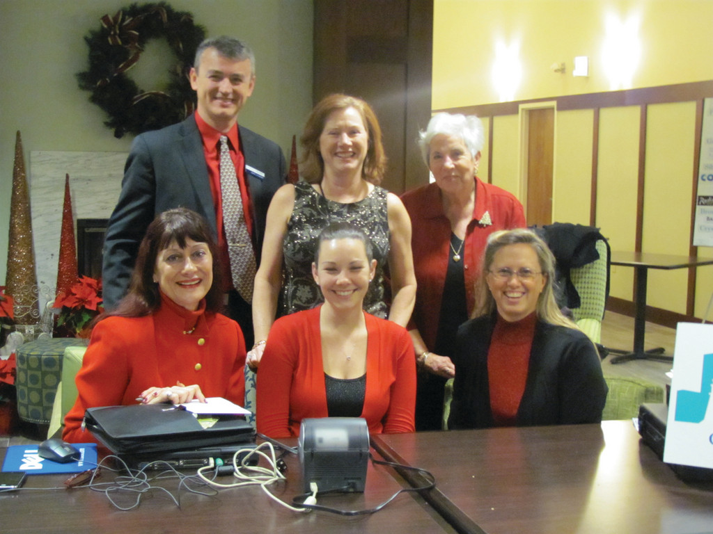 HOLIDAY HOSTS: More than 125 people turned out for last Wednesday's Central Rhode Island Chamber of Commerce Christmas Party and December Business After Hours, which was held at the Hampton Inn & Suites on Post Road in Warwick. Some of the people who were largely responsible for the night's great success were, in front from left: Bunny Feiler, Sarah Stoves and President/CEO Lauren Slocum. Top: General Manager Jay Visnjic, Denise Drouin and Yvette Mellin.